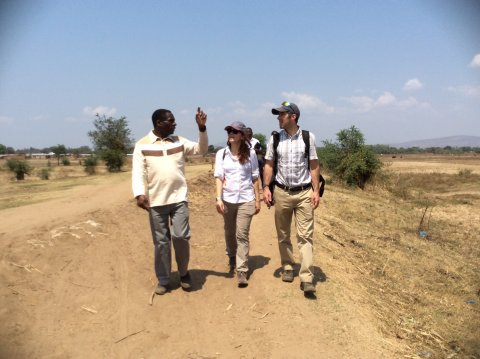 Dominic Kamlomo from Mzuzu University shows Faith and James the dyke which was built to protect Karonga from flooding